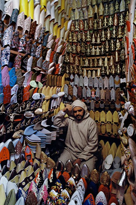 Morocco.Fez.A man sits in a shoe store.1988