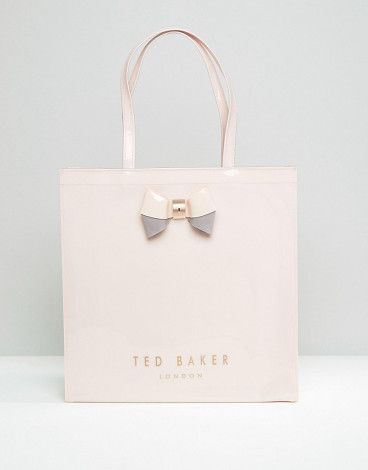 Large icon bag in pale pink by Ted Baker. Cart by Ted Baker, Glossy outer, Unlined design, Twin handles, Open top, Structured bow, Interior zip pocket, Do not ...