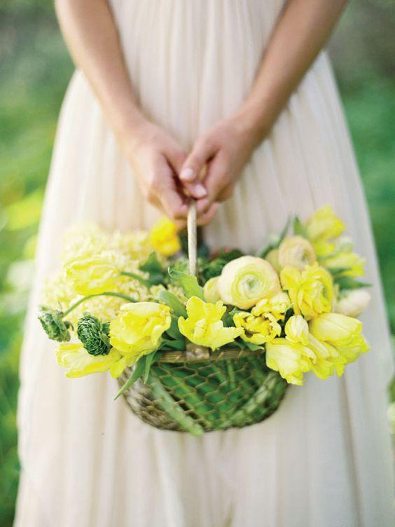 Gorgeous yellow flowers in a basket. Jose Villa