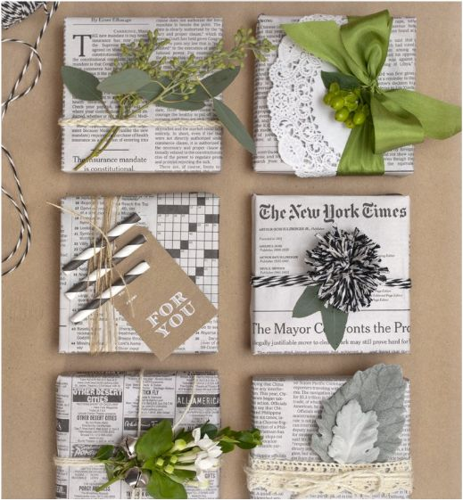 newspaper gift wrap with Pom Pom