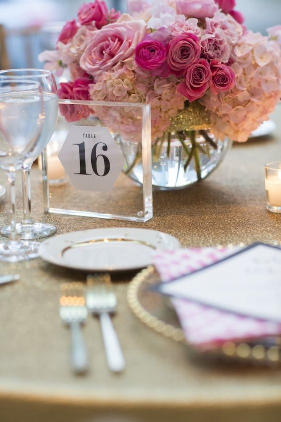 Gorgeous pink wedding centerpiece idea; photo: Cadence and Eli