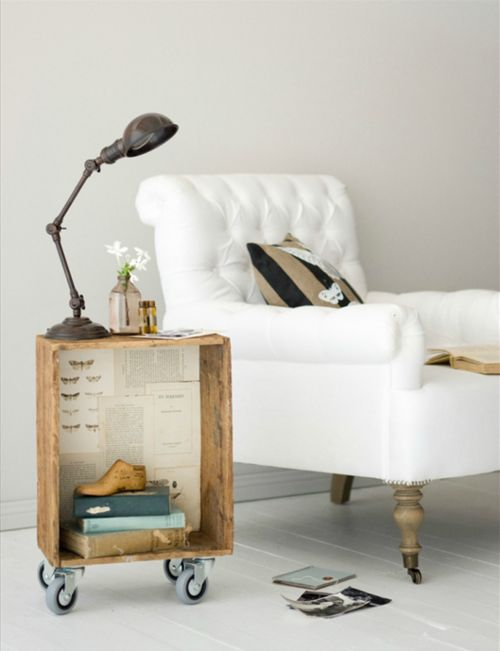 crate on casters side table + pretty armchair