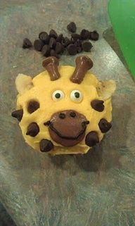 ((bad link)) yellow frosting, chocolate chips, chocolate wafer, brown icing, almond ears and pretzel sticks.