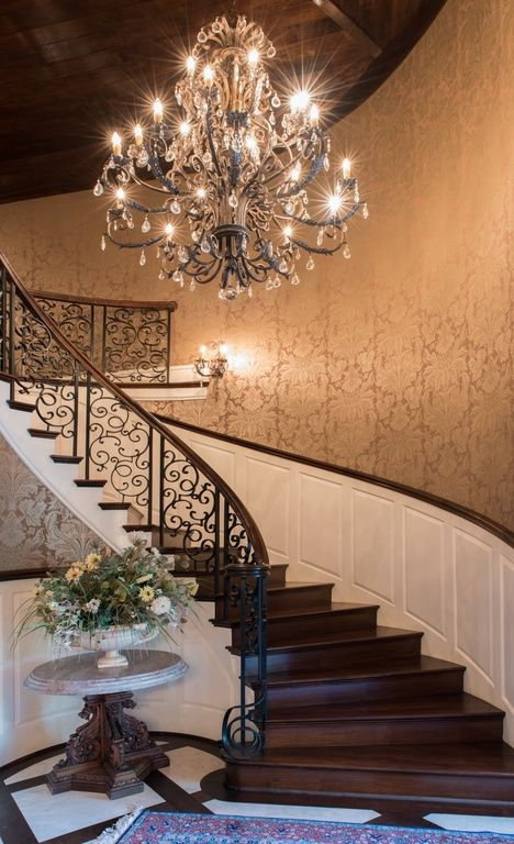 Traditional Staircase with Wainscoting, Chandelier, Hardwood floors, Exposed beam, High ceiling, Wall sconce