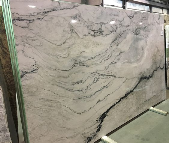 Welcome Venatino Blue Quartzite! The name says blue, but this unique Quartzite is mostly variations of grays with strong black veining. When you put it all together, the colors and the movement, very pleasing to look at and is a beautiful natural stone.