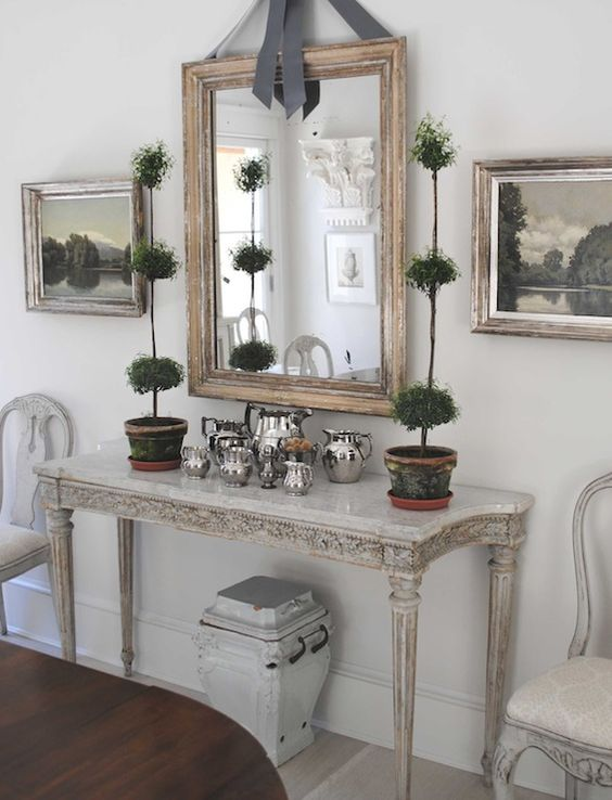 Silver Foyer Mirror : Neutral foyer with silver pieces carved console tall