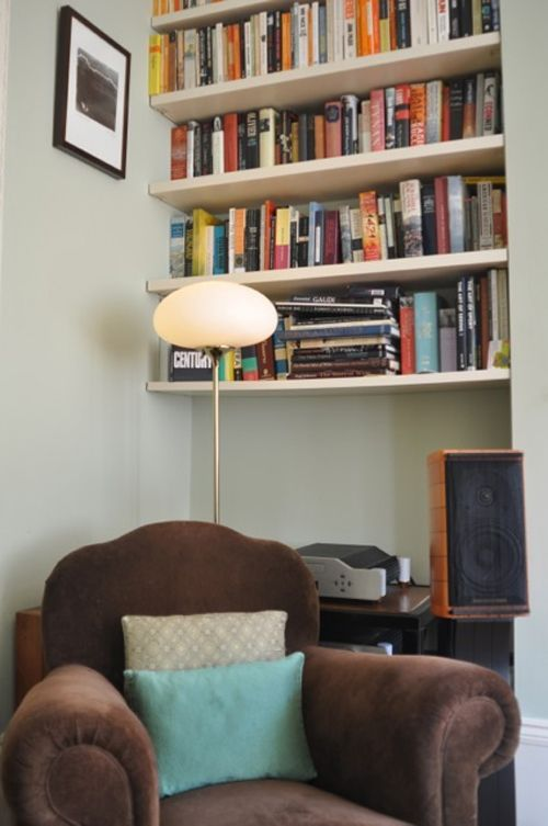 bookshelves high up on the wall and reading nook
