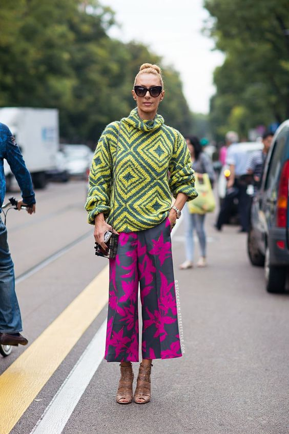 Best Outfit Ideas For Fall And Winter  31 Perfect Ways to Wear a Chunky Knit Sweater  Best Outfit Ideas For Fall And Winter 2016/2017 Description How to Style a Chunky Knit Sweater - bright geometric motif sweater  tropical print cropped wide leg pant and strappy sandals | StyleCaster
