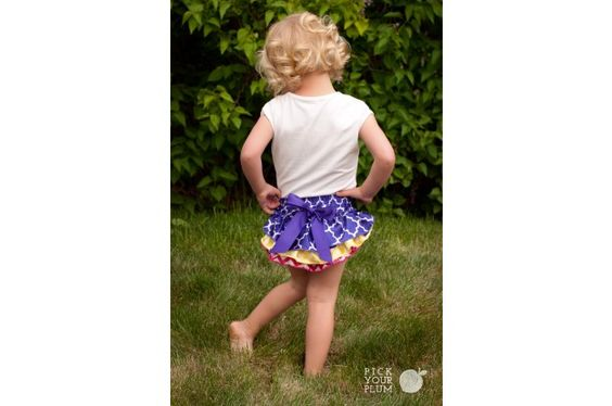 Model is wearing: 'By the Coat Tails: (PURPLE/YELLOW/RED) Multi Pattern Ruffle Bloomer '