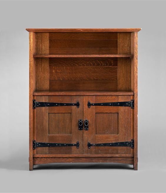 GUSTAV STICKLEY: Extremely rare sideboard (no 966) C. 1901 -1902. Open fixed-shelf display over two paneled quartersawn oak doors with strap hinge hardware.