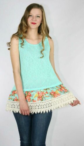 Mint sleeveless top with floral panel and wide ornate trim. www.rhinestonegal.com