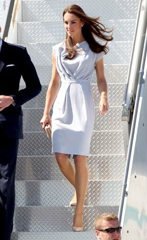 Catherine makes another gorgeous entrance, arriving in Los Angeles in a draped, dove-gray dress by London designer Roksanda Ilincic. Nude pumps and an L.K. Bennett clutch complete her ensemble.
