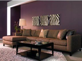 Purple wall brown couch dont look at the zebra stripe Purple brown living room