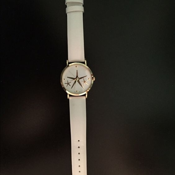 White and gold starfish watch Charming Charlie white and gold starfish watch! Never worn! Plastic piece still on back of watch. Bought this summer. Charming Charlie Accessories Watches