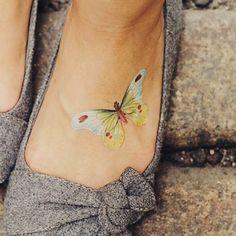 Tatuajes para mujeres en el pie: fotos de los diseños:
