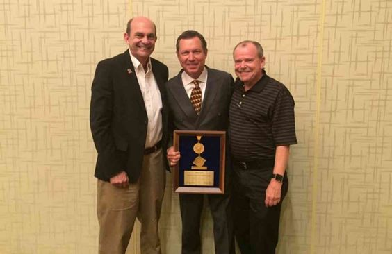 Premier Rides President Honoured With #ASTM International 2015 Award. Jim Seay pictured centre between Greg Hale, Vice President and Chief Safety Officer, Walt Disney Parks and Resorts and Jim Pattison, Jr., President, Ripley Entertainment