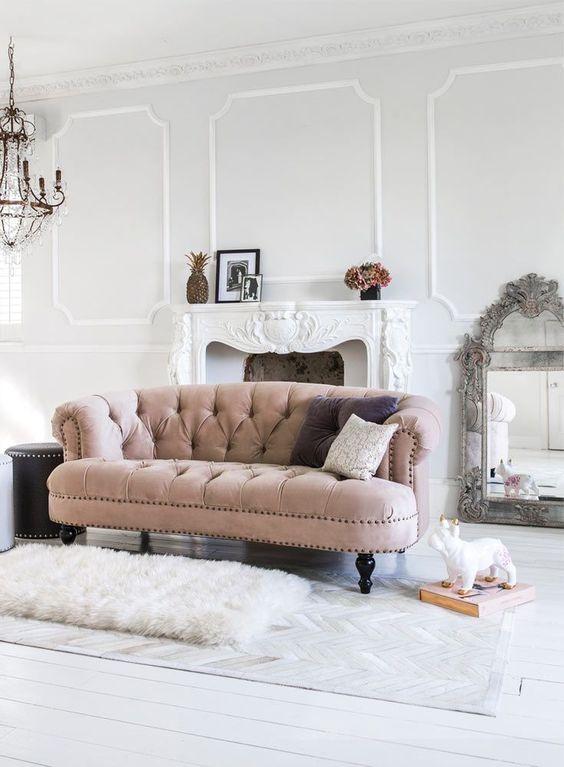 White walls and velvet sofa