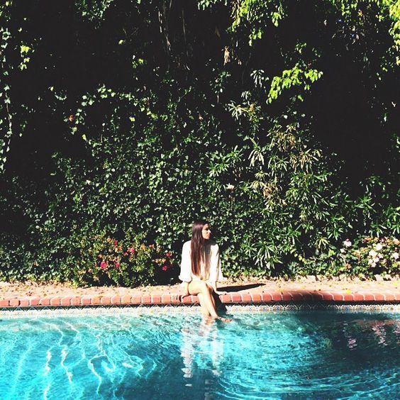 LA swimming pool. Girl wearing Rhode Resort.