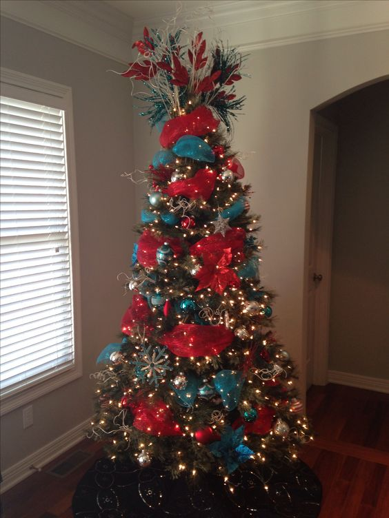 The ribbon christmas trees and trees on pinterest for Red ribbon around tree