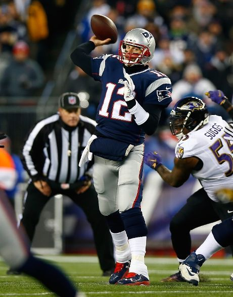 Baltimore Ravens vs. New England Patriots - Tom Brady #12 of the New England Patriots passes in the first quarter against the Baltimore Ravens during the 2014 AFC Divisional Playoffs game at Gillette Stadium on January 10, 2015 in Foxboro, Massachusetts. (Photo by Jared Wickerham/Getty Images)