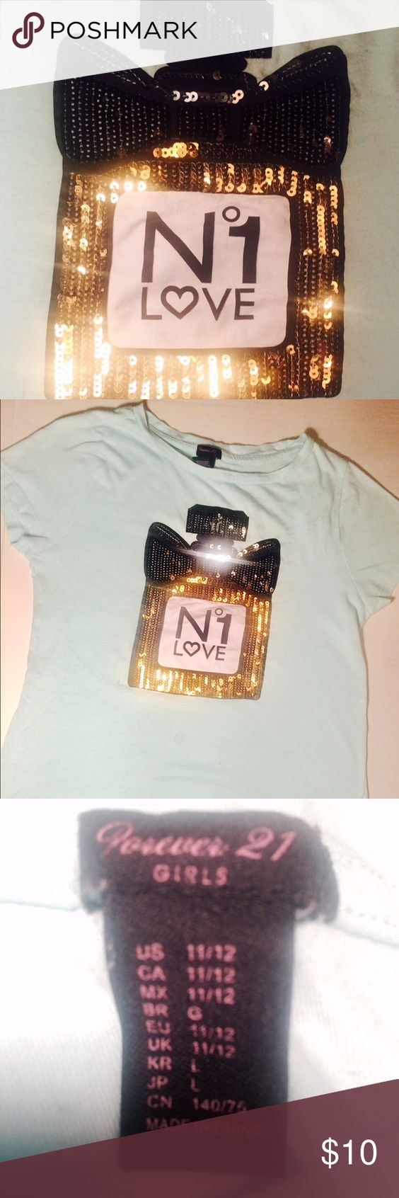 Fun sparkling T This shirt is so adorable and perfect for any tween. I'm great condition Forever 21 Shirts & Tops Tees - Short Sleeve