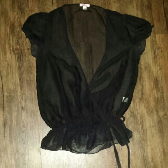 NWOT Black Sheer Wrap Top Brand new without tags..size medium..black sheer top that wraps in the front with an elastic waistband and ties on the front side..very cute top! Xhilaration Tops Blouses
