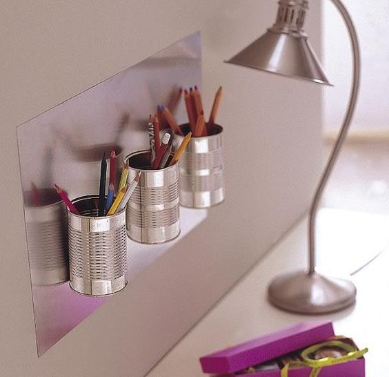 Attach clean, used cans to a large magnetic board. What a perfect way to easily organize all your kid's crazy art supplies- and skip those expensive acrylic organizers.