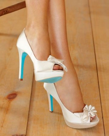 """A Twist on Something Blue: The Pour La Victoire """"Stella"""" shoes (Zappos.com) are the classic wedding pumps -- white satin, decorative bow, peep toe -- but the sole is a vivid aqua."""