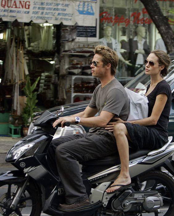 Brad Pitt and Angelina Jolie in Ho Chi Minh City, Nov. 23, 2006. They should really wear helmets.