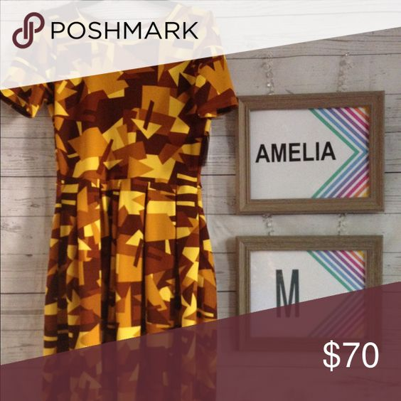 Amelia lularoe The Amelia dress stretching fabric is comfortable enough to let you wear the dress all day, while having the structure and tolerating that you can make it sophisticated enough for the office or a fancy night out. LuLaRoe Dresses Midi