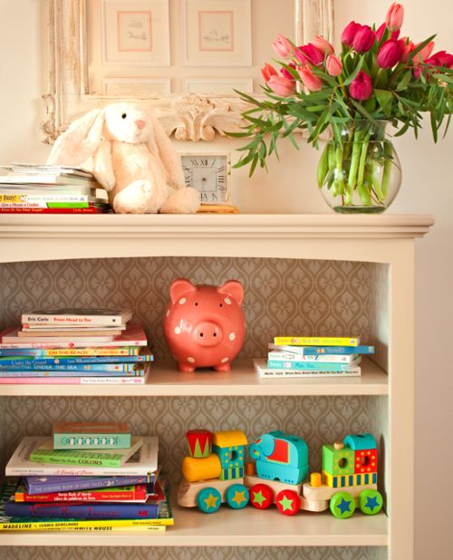 Wallpaper or stencil the back of a bookshelf! Adorable!