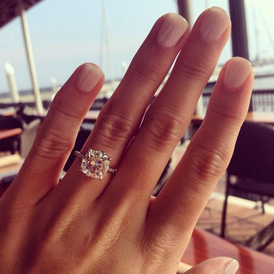 """""""The center stone is a 9.5 mm cushion cut Forever Brilliant moissanite."""" Beautiful"""