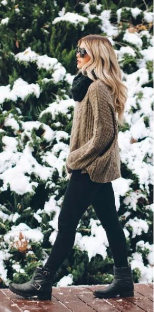 This tan cableknit sweater is comfy and cute with the leggings and combat boots: