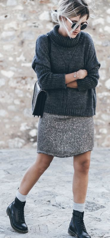 Wear your grey knit sweater with a grey skirt, grey socks and a pair of Dr. Martens. Via Jacqueline Mikuta. Sweater: VILA, Skirt � Anncha, Boots: Dr.Martens, Bag: Zara, Sunglasses: ZeroUV:
