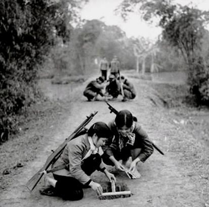 NVA picture showing young VC girls laying booby traps