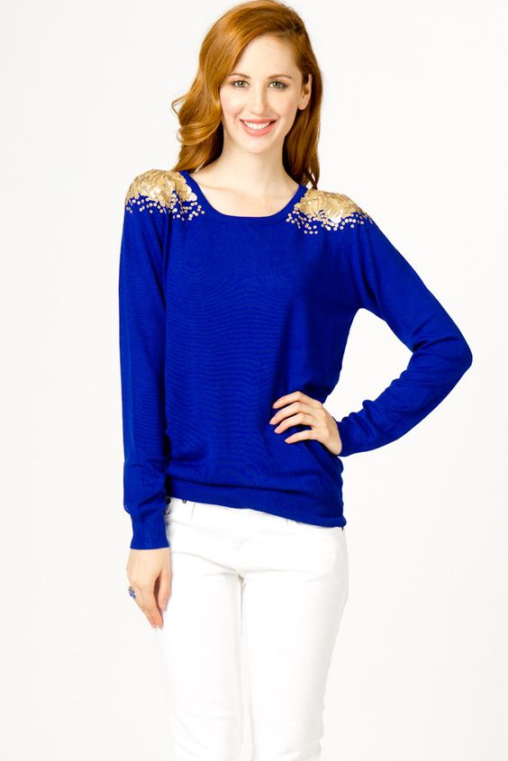 bright blue sweater with gold sequin shoulders