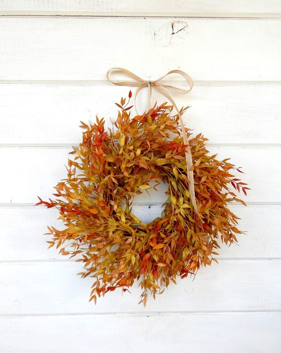 This fall wreath screams fall foliage!! This wreath is perfect for my front door or all the windows. #fall #falldecor #fallwreath #wreath #autumn #autumndecor Fall Wreaths for Every Budget - Pretty Collected