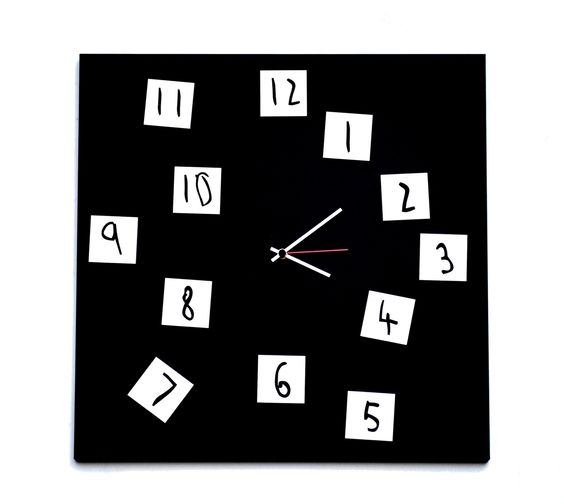 IT 420B - CHANGING CLOCK  50×50 cm  Design: Leonardo Roverato    Tick-tock. With this Changing Clock by dESIGNoBJECT.it, the fact that the seconds, minutes and hours sometimes seem to pass you by in a flash suddenly doesn't seem so bad! The board sports 12 little magnets with the clock's numbers that can be placed in any order you wish, adding a playful element to this design. The times they are a changin'.