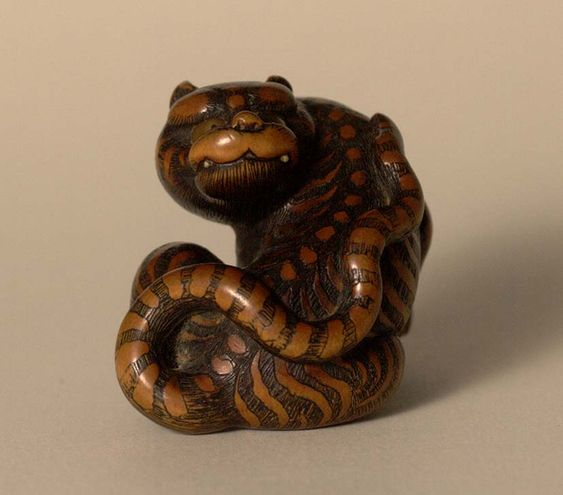 Sitting tiger, by Toyomasa, late 18th c (boxwood)