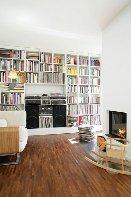 Example of how the built-ins in the living room, will need space for two large speakers (taking up space where the cabinets would go) and that some of the shelving is sized for records, CD, and also books. I picture the speakers wider apart however....