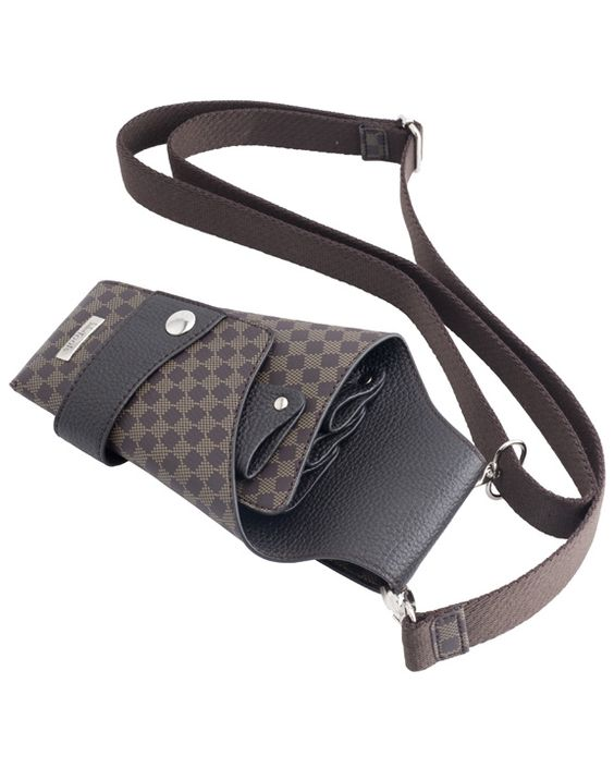 """Cross body leather tool holder.  For stylist keep everything close. Hold on to your hear clips, shears and everything you need to be more efficient. Designer Style 3 Waist Tool Pouch  •Approx 9""""H x 5""""W •Holds 4 pairs of shears plus styling tools •Unsnapped wide open for easy cleaning Color: Brown - $35.00 http://www.strandshaircare.com/"""