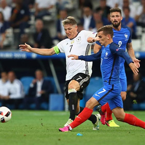 Bastian Schweinsteiger (white jacket) Germany and Antoine Griezman of France  clicked during their semi-final match of Germany vs. France on 07/07/2016.