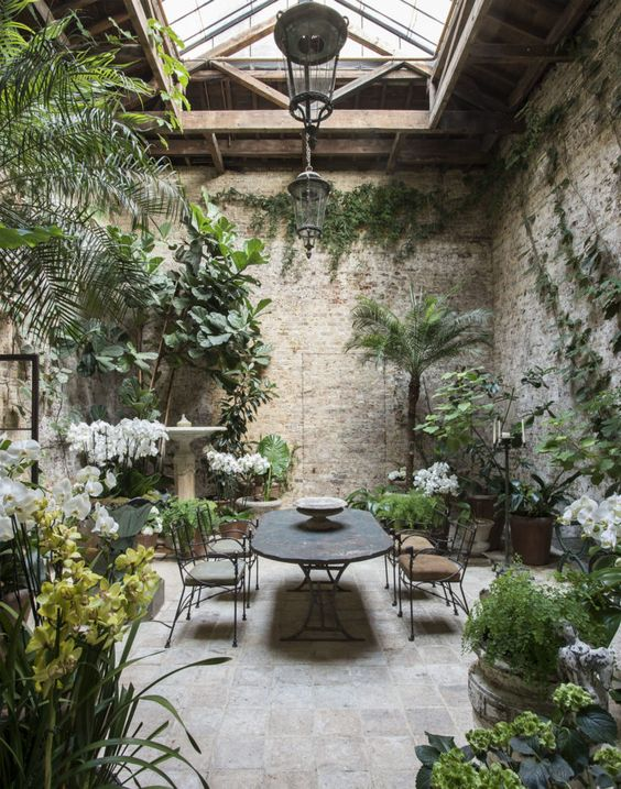 The winter garden in Rose Uniacke's Pimlico home in London. Rose Uniacke's Classic Designed Minimal Home in London.