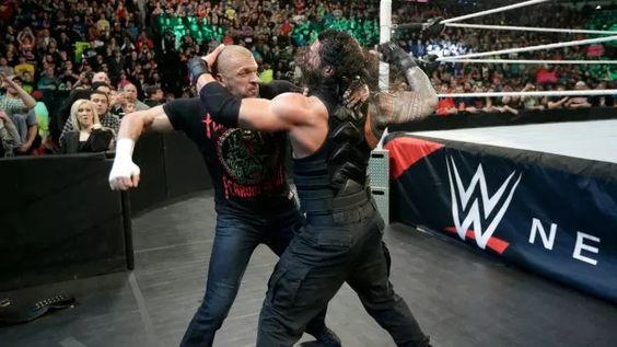 Triple H and Reigns brawl!