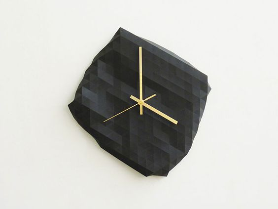 Miss Moss : Living. faceted wall clock by Raw Dezign
