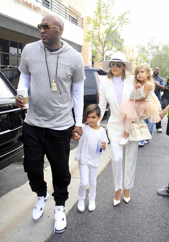 It's an annual tradition! Khloe Kardashian holds Penelope Disick as she walks with Lamar Odom and Mason Disick as they arrive for church in Agoura Hills on Easter Sunday.