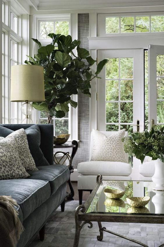 pretty sun room beautifully styled | sucker for transom windows and French doors: