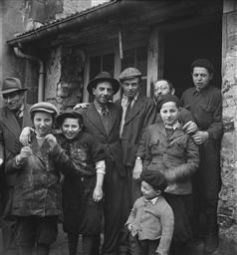 Refugees and Displaced Persons' Camps, Germany and France, 1947 | Roman Vishniac Archive [Holocaust survivors gathering outside a building where matzoh is baked)