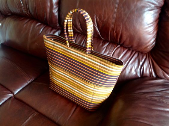 Striped African print handbag. Nice as a work or travel bag. Will comfortably hold all your essentials. This print available in different styles. Great @ $60! Will ship. Janeth_Okoronkwo@yahoo.com