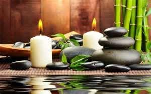 Bambú, velas, piedras y agua